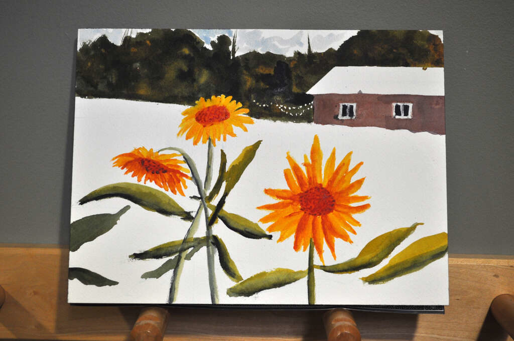 painting of sunflowers with barn and woods in background, masking fluid removed