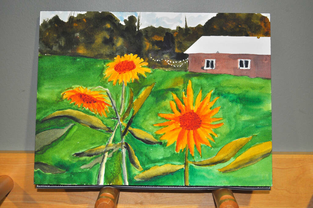 painting of sunflowers with barn and woods in background, added lawn