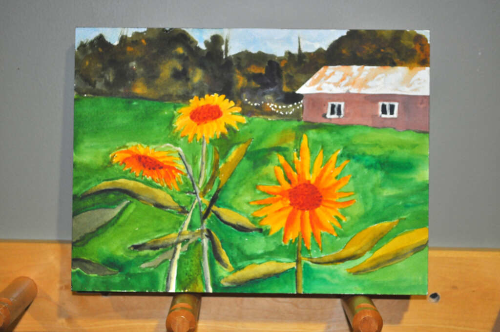 painting of sunflowers with barn and woods in background, added colour to roof of barn
