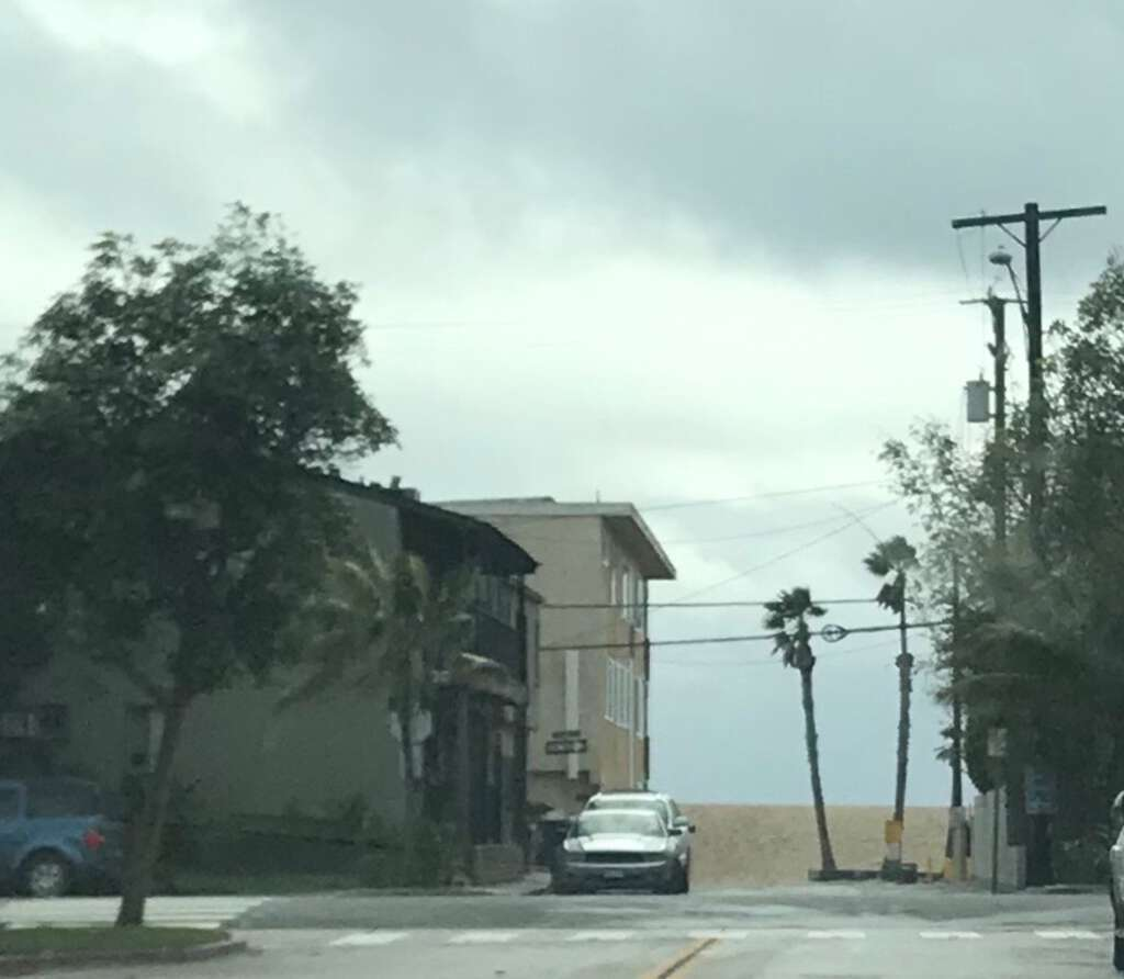 Source photo: Seal Beach, California. Looking through narrow street towards beach, overcast with marine layer